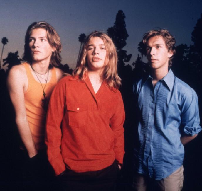 REKORDKNUSER: Hanson ble stiftet før noen av medlemmene havnet i tenårene, noe som gjorde at Zac ( i midten) i en alder av 12, fikk rekorden for å være den yngste låtskriveren som har blitt nominert til en Grammy. Foto: REUTERS / NTB