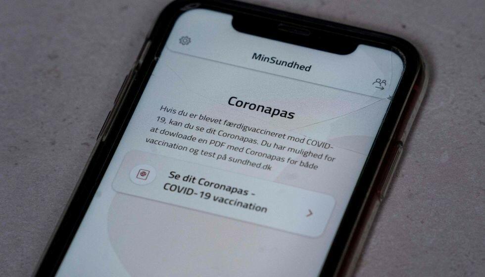 MIN SUNDHED: Danmarks midlertidige løsning på coronapass dokumenterer om man er vaksinert eller har immunitet etter gjennomgått covid-19-infeksjon. Foto: Liselotte Sabroe / Ritzau /AFP / NTB