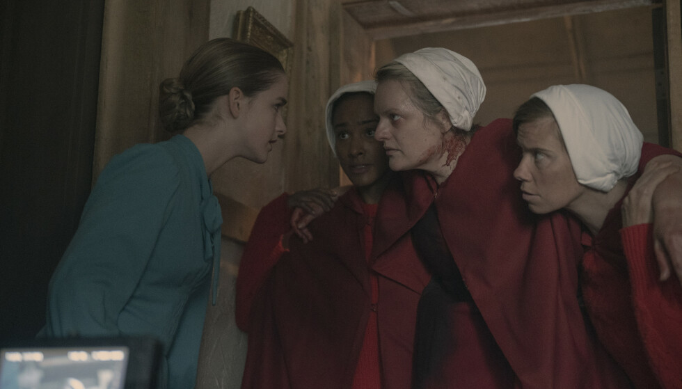 "The Handmaid's Tale -- ""Pigs"" - Episode 401 -- On the run after the end of Season 3, an injured June and the fugitive Handmaids find refuge at a farm, where the 14-year-old Wife nurses June back to health. June restores her role as the women's leader. In Gilead, an imprisoned Lawrence tries to avoid a death sentence, and Aunt Lydia reels from the loss of 86 children on Angels' Flight. The combative Waterfords, in custody in Toronto, learn of June's feat. Mrs. Keyes (McKenna Grace) and June (Elisabeth Moss), shown. (Photo by: Sophie Giraud/Hulu)"