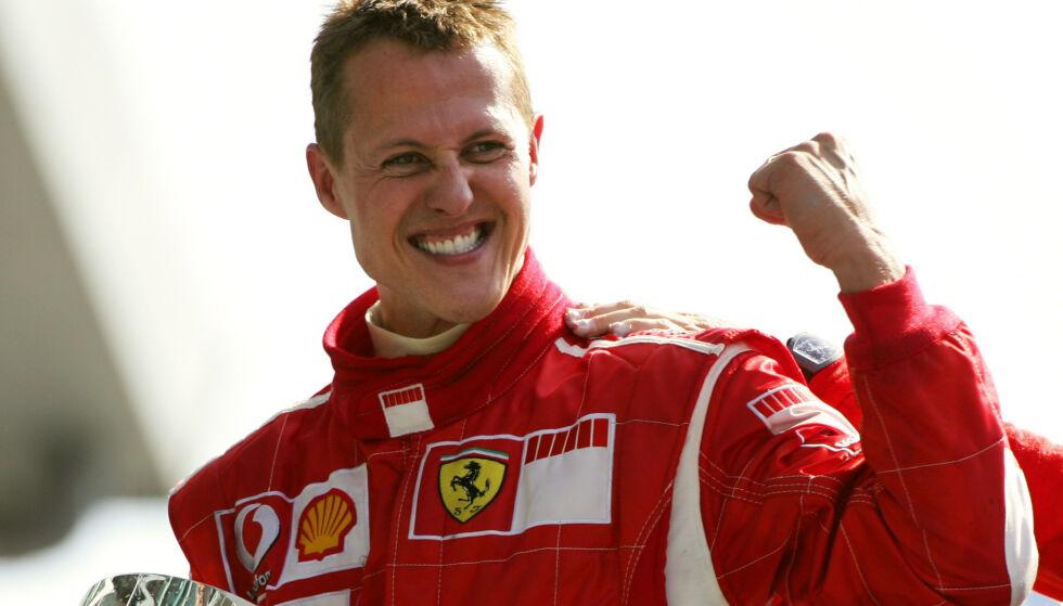 LEGENDE: Michael Schumacher etter én av sine mange seire, her i Monza. Foto: NTB