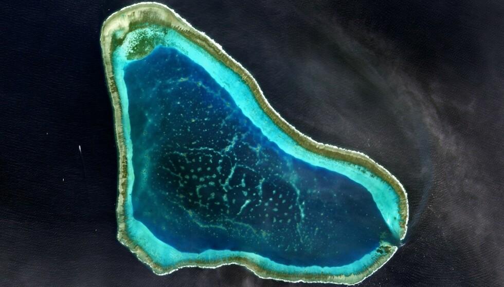 UØNSKET: Filippinenes utenriksminister er tydelig på at kinesiske fartøy ikke er ønsket i området Scarborough Shoal. Foto: NASA