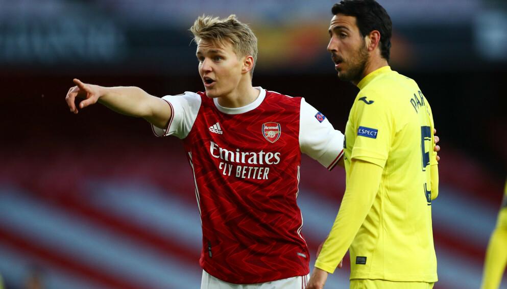 OVER OG UT: Martin Ødegaard og Arsenal måtte til slutt gi tapt for Dani Parejo og Villarreal. Foto: REUTERS/Hannah Mckay