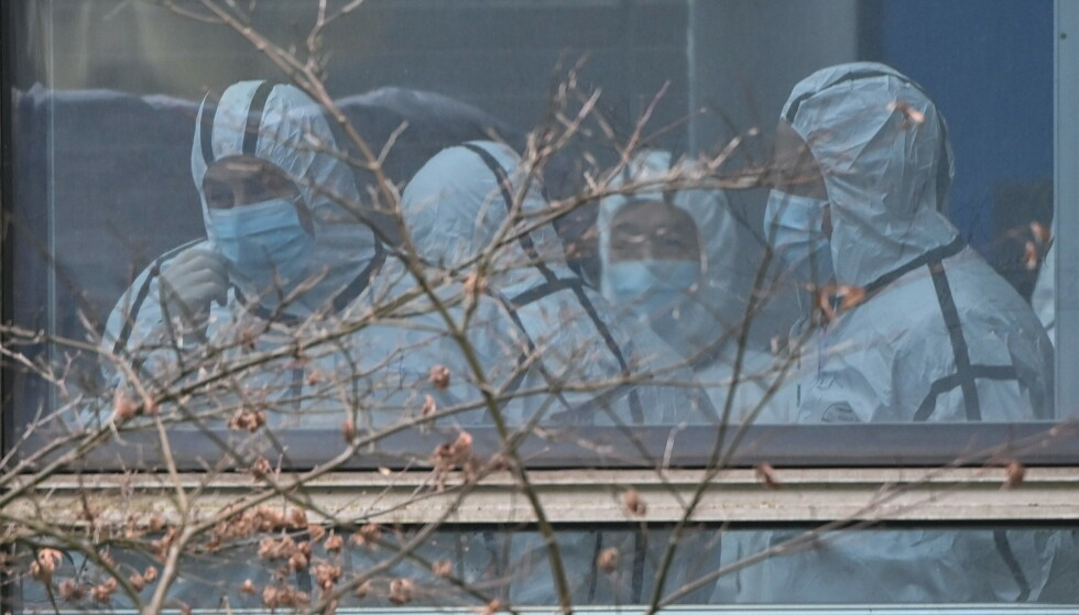UNDERSØKTE: Representanter fra WHO på besøk i Wuhan i februar 2021. Hoto: Hector Retamal / AFP / NTB