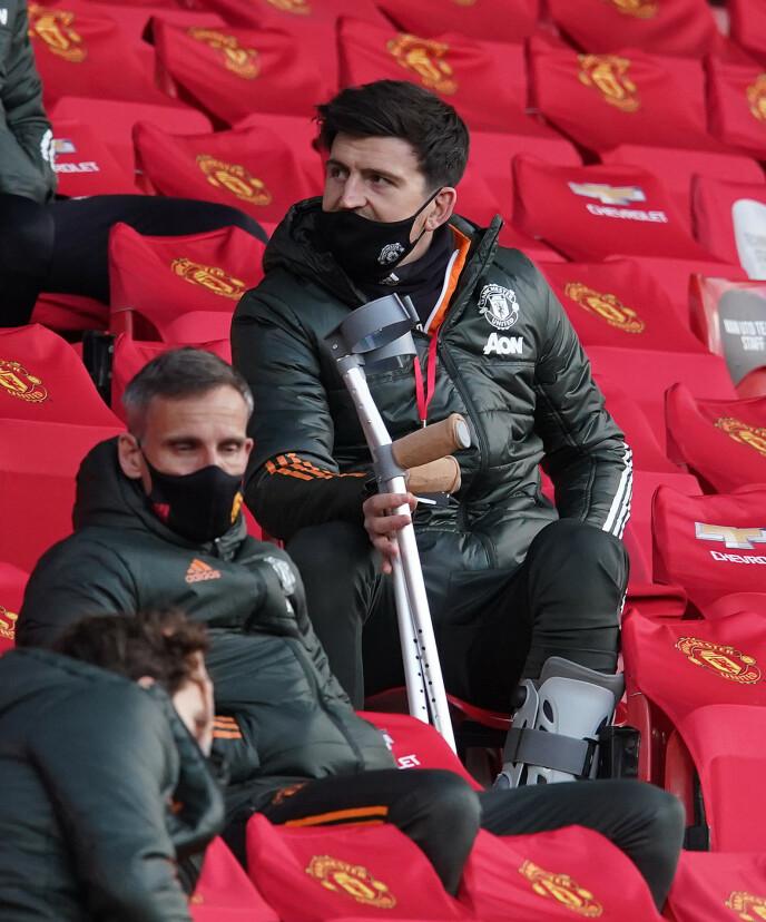 PÅ SIDELINJA: Manchester United savner sin skadde kaptein, Harry Maguire. Foto: NTB