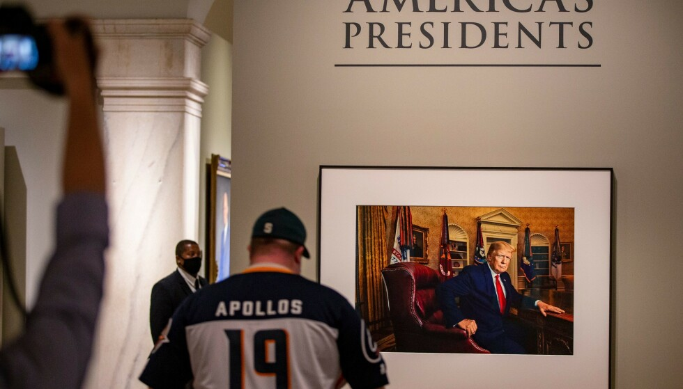 Celebrity status: Trump sits at his desk in the Oval Office and wears his familiar red tie.  Photo: NTP / TAOS KOTOPODIS / UPI National Portrait Gallery reopens