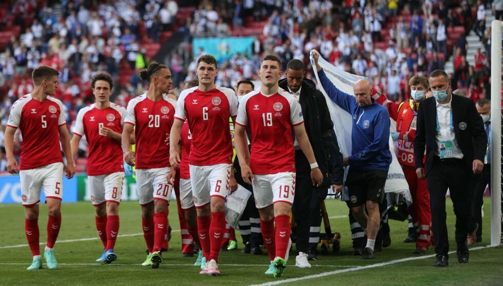 I SJOKK: De danske spillerne skal være langt fra fornøyde med ultimatumet de fikk etter Eriksens kollaps. Foto: AFP