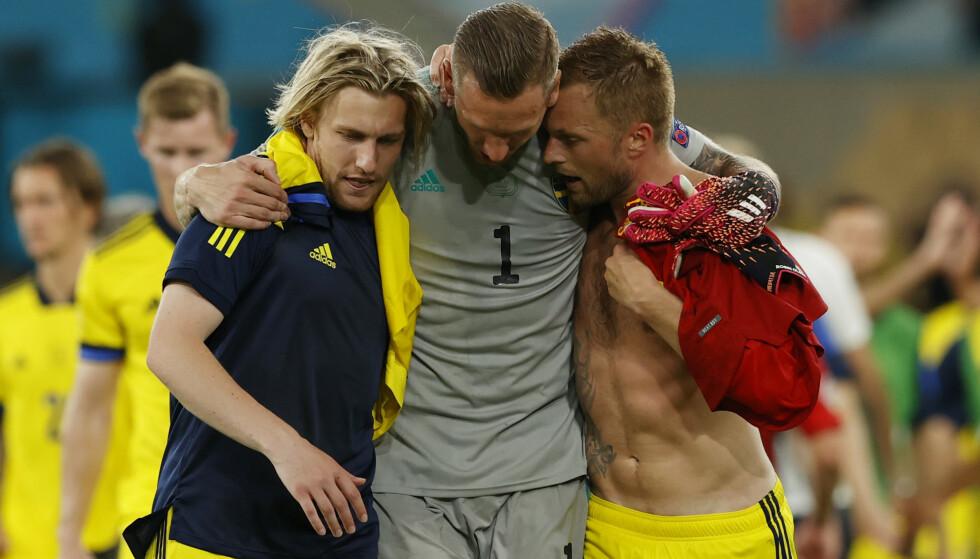FORNØYDE: Sverige kjempet tappert i 90 minutter og tok et kruttsterkt poeng mot Spania. Foto: Reuters