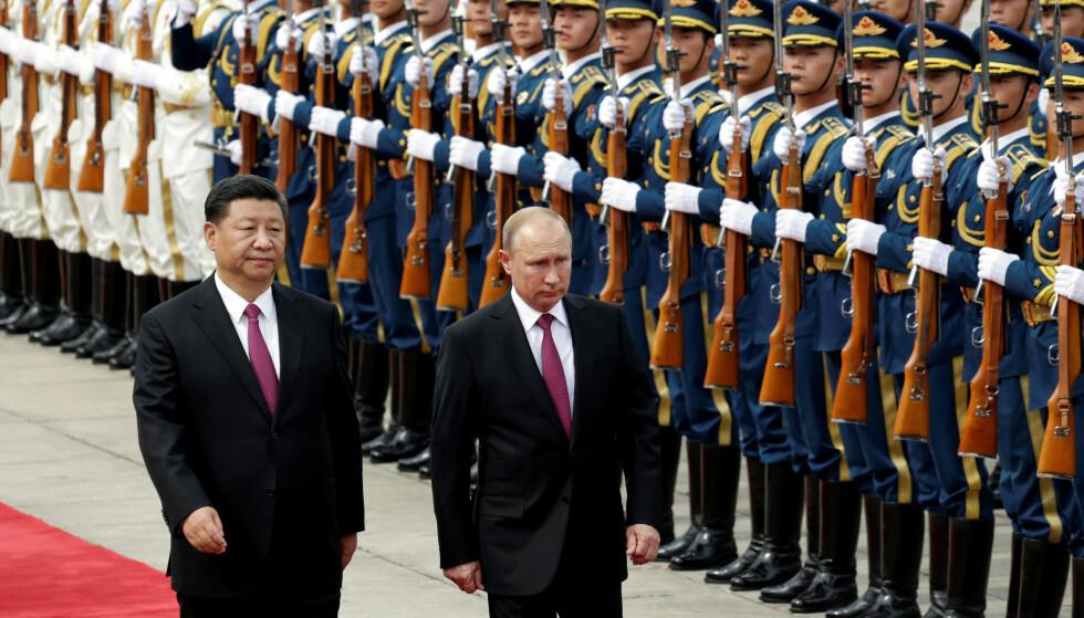 2018: Kinas president Xi Jinping og Russlands president Vladimir Putin under en velkomstseremoni i Beijing. Foto: Reuters / NTB