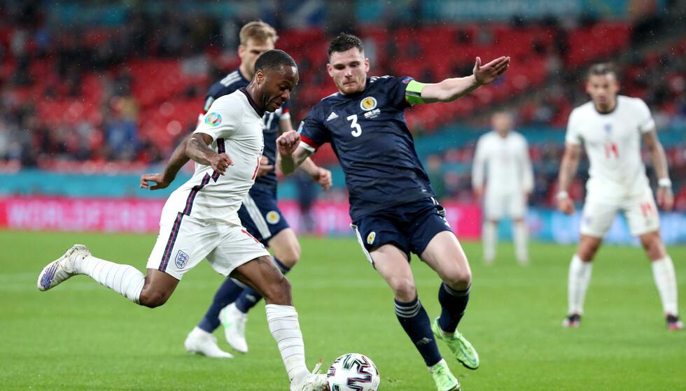 KJEMPET: Liverpool-back Andy Robertson og Skottland kriget seg til ett poeng. Foto: Pa