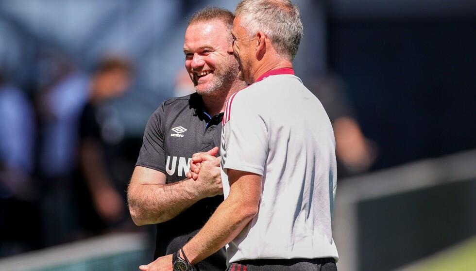 GAMLE VENNER: Wayne Rooney og Ole Gunnar Solskjær under en sesongoppkjøringskamp i juli 2021. Foto: Nigel Keene / ProSports / Shutterstock / NTB