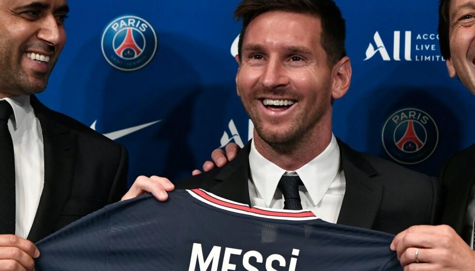 GOD STEMNING: Lionel Messi strålende fornøyd med å ha signert for PSG. Foto: AFP