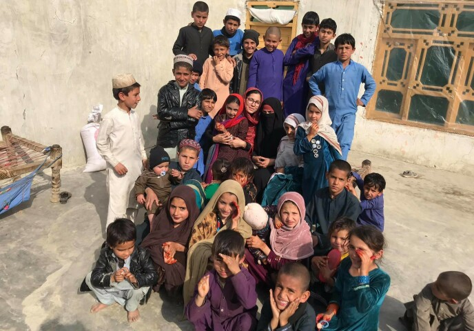 At work: Ayesha Wolesmal is with her children in the Axin province of Afghanistan.  Photo: Private