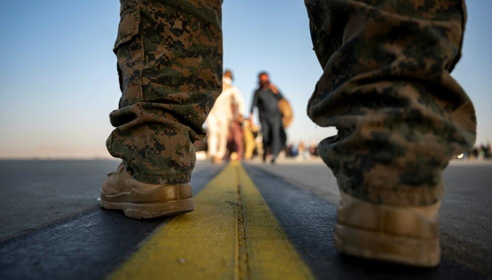 HASTER: Evakueringen av Afghanistan har mest sannsynlig er begrenset vindu. Tiden er nå, skriver innsenderne. Her evakuerer et militærfly fra USA mennesker som vil vekk fra landet. Foto: U.S. Air Force / REUTERS/ NTB