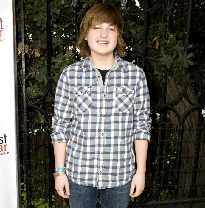 SUPERSTJERNE: Angus ble verdenskjent i svært ung alder. Her i Los Angeles i 2009. Foto: Vincent Sandoval/BEI/REX/NTB