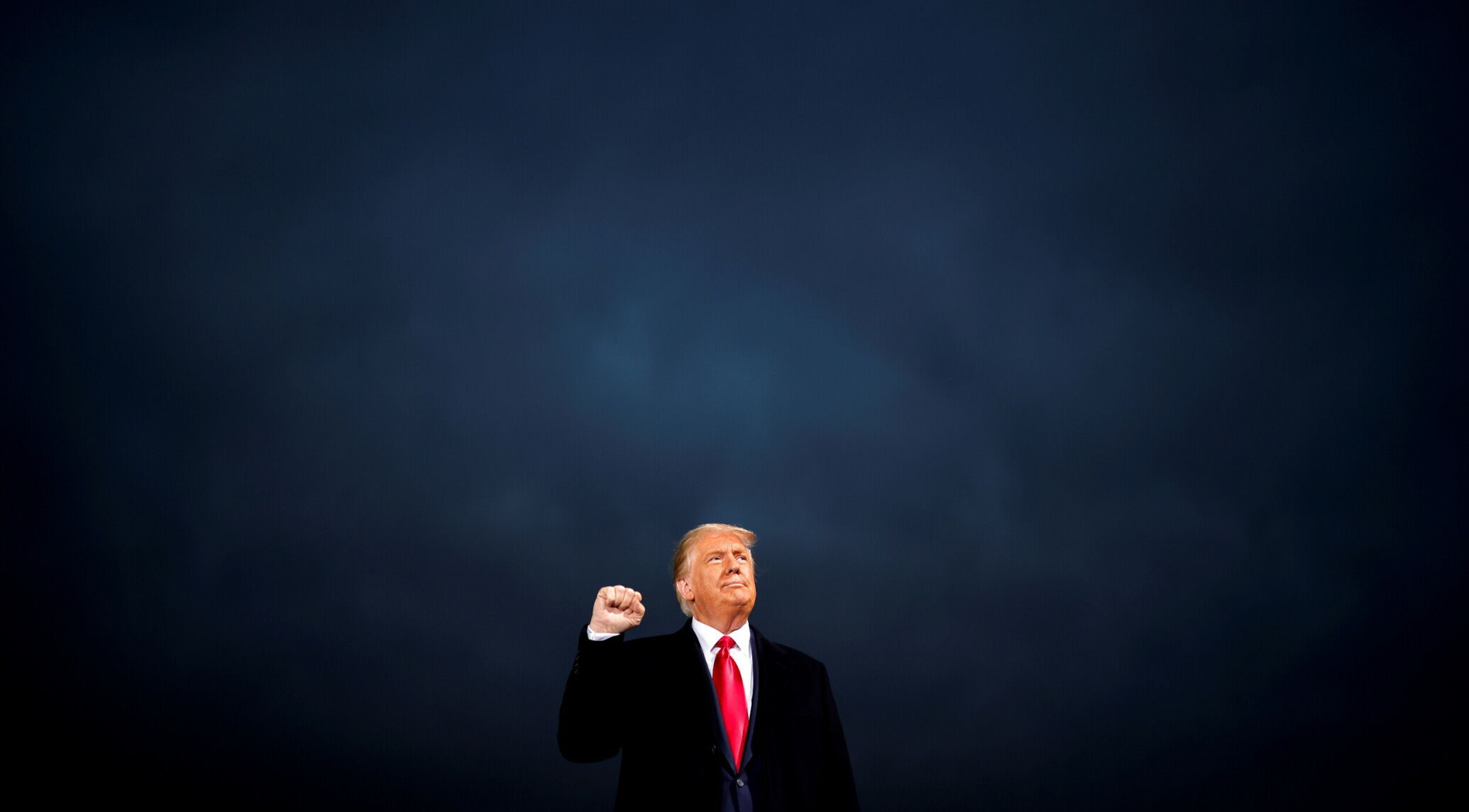 """U.S. President Donald Trump makes a fist during a campaign rally at Des Moines International Airport in Des Moines, Iowa, U.S., October 14, 2020. REUTERS/Carlos Barria/File Photo     TPX IMAGES OF THE DAY     SEARCH """"POY USA ELECTION"""" FOR THIS STORY. SEARCH """"WIDER IMAGE"""" FOR ALL STORIES"""