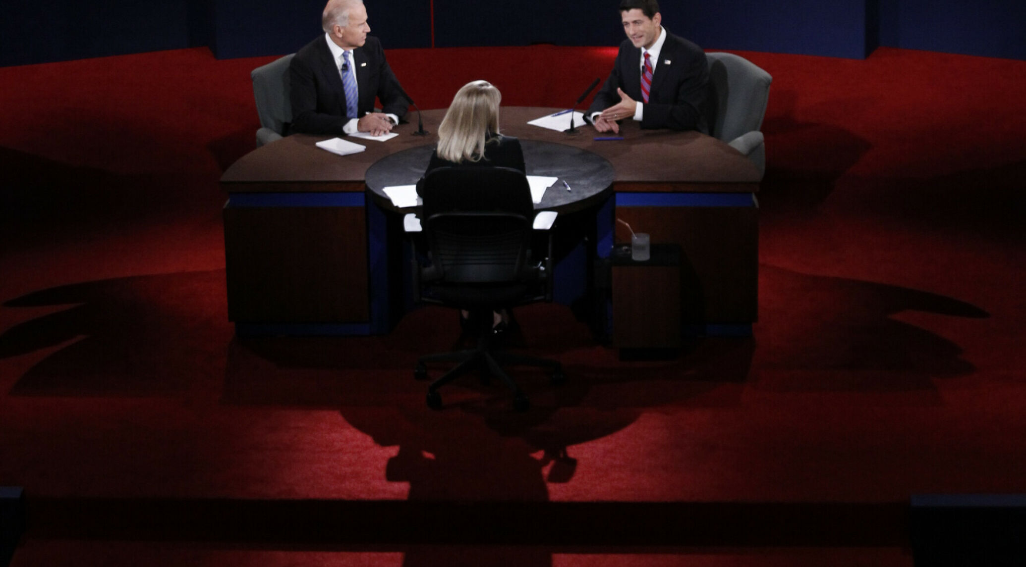 Moderator Martha Raddatz (C) and U.S. Vice President Joe Biden (L) listen as Republican vice presidential nominee Paul Ryan speaks during the U.S. vice presidential debate in Danville, Kentucky, October 11, 2012.    REUTERS/Jeff Haynes (UNITED STATES  - Tags: POLITICS ELECTIONS USA PRESIDENTIAL ELECTION)