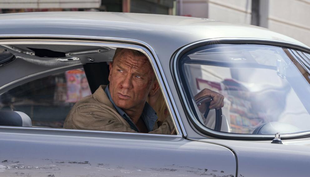 GIR SEG: Etter 15 år gir Daniel Craig seg som James Bond. Her i den siste, kommende filmen «No Time To Die». Foto: Nicola Dove/AP/NTB