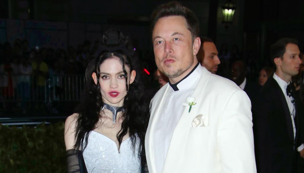 OVER OG UT: Elon Musk kan fredag avsløre at han og kjæresten Grimes har gått hver til sitt. Foto: Matt Baron/REX/NTB