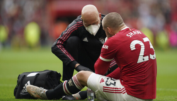 Manchester United's Luke Shaw is injured during the English Premier League soccer match between Manchester United and Aston Villa at the Old Trafford stadium in Manchester, England, Saturday, Sept 25, 2021. (AP Photo/Jon Super)
